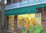 Shop front of Feminist Book shop is closed but lights are on inside