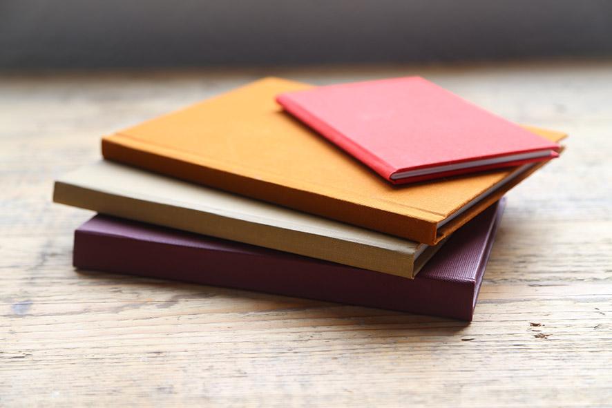 Pile of case bound hardback books