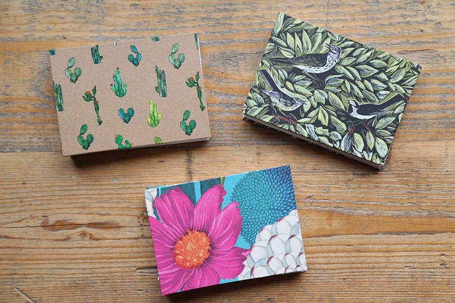 Photo of 3 pocket sized sketchbooks