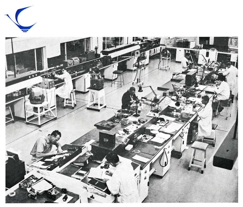 Black and white photograph of workers in the electrical and instrument section of the airline