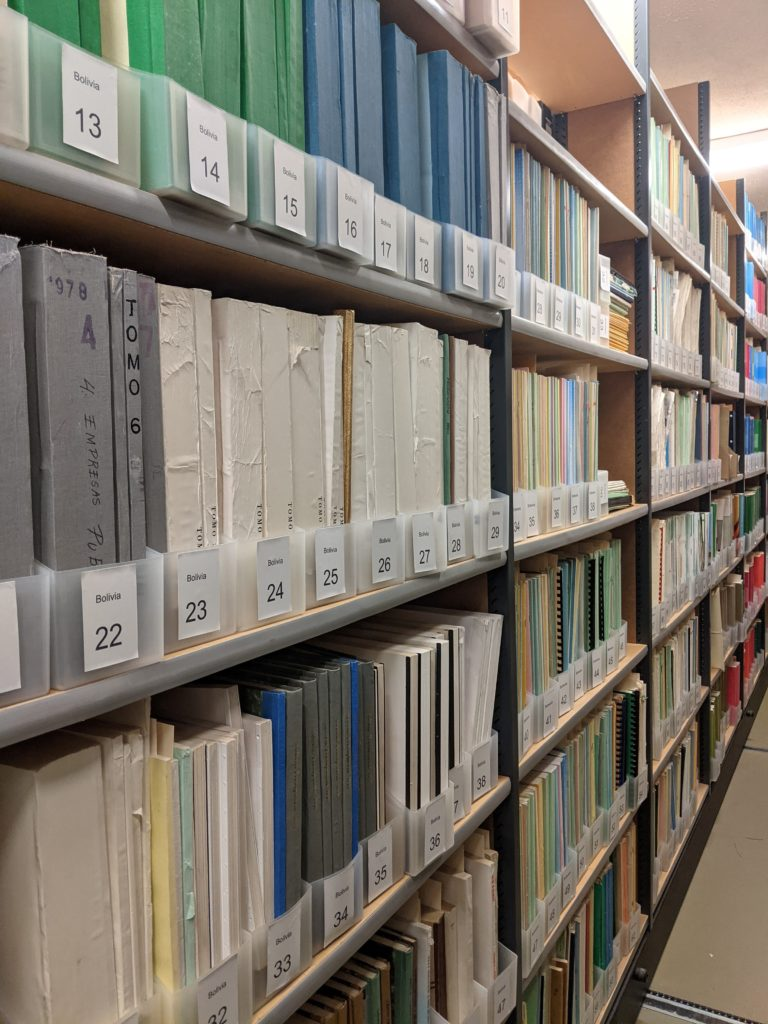 Image of library stacks with pamphlet boxes and pamphlets