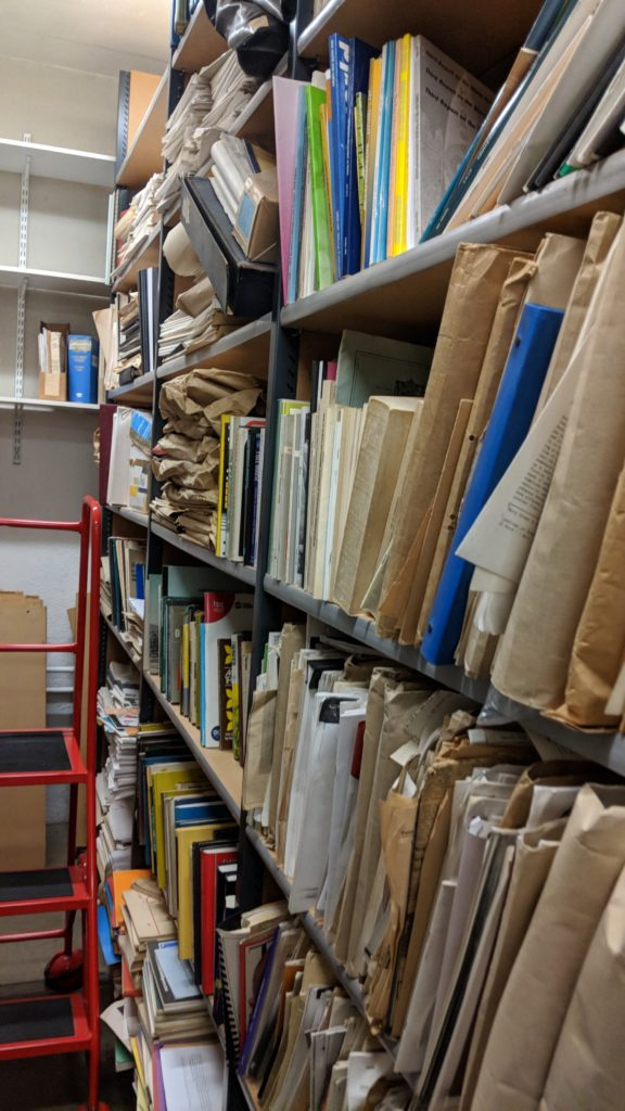 Image of library stacks full of documents before being ordered by BLDS