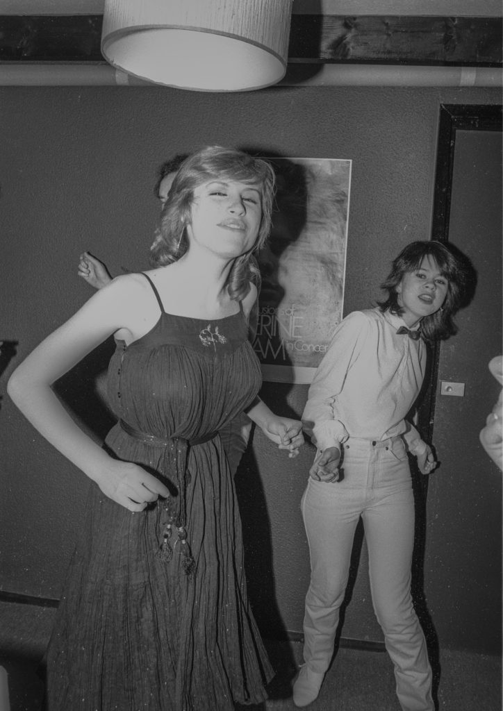 Black and white photo of 2 people dancing at a party