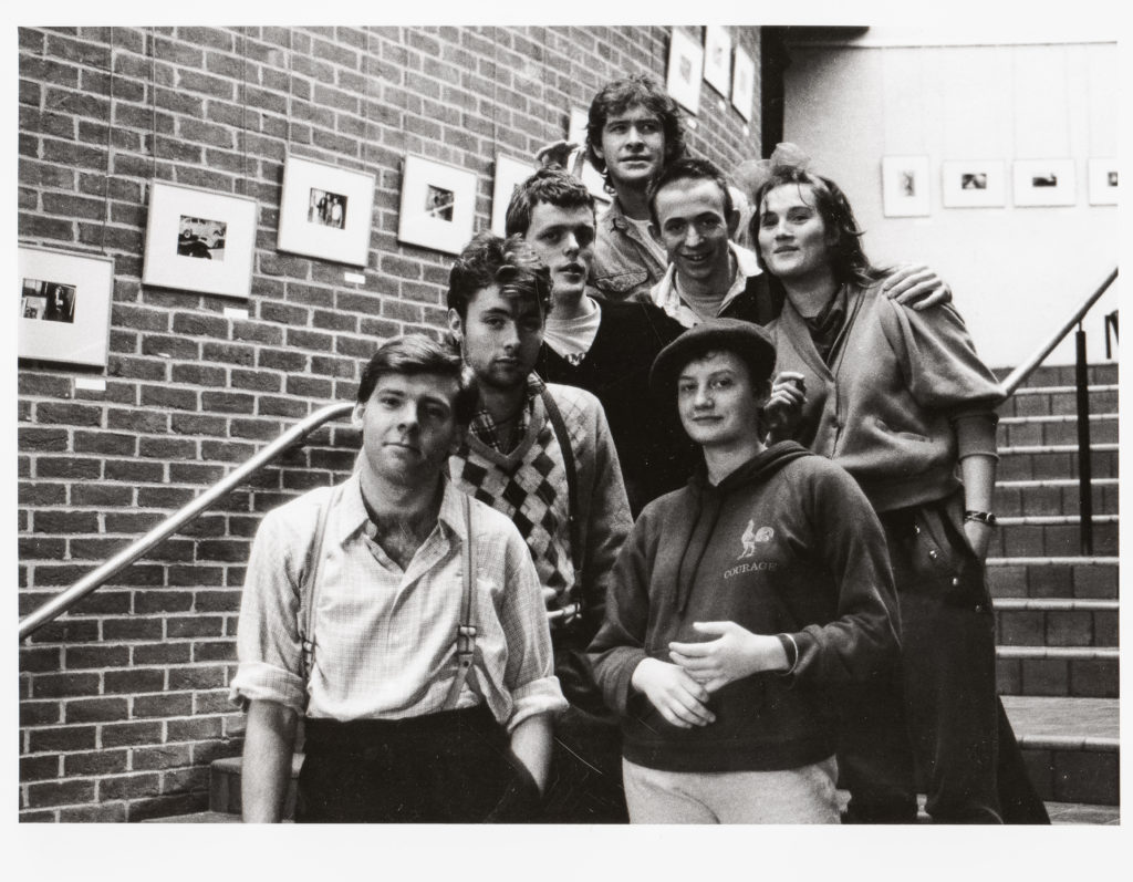 Black and white group photo of actors from Bright Red