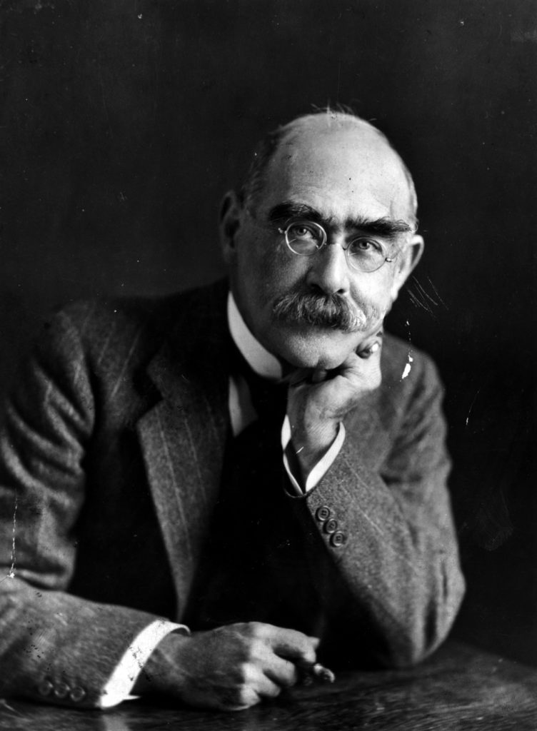 A portrait of Rudyard Kipling looking directly at the camera with his head resting on his left hand