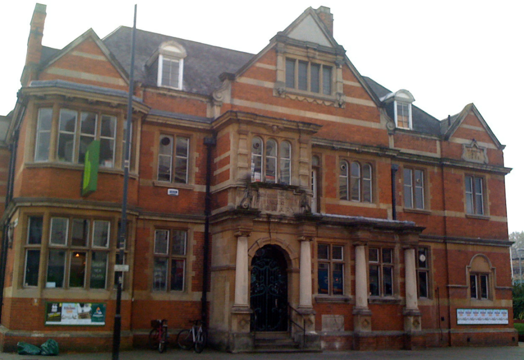 Late 19th century red brick facade of Shepherds Bush Public Library