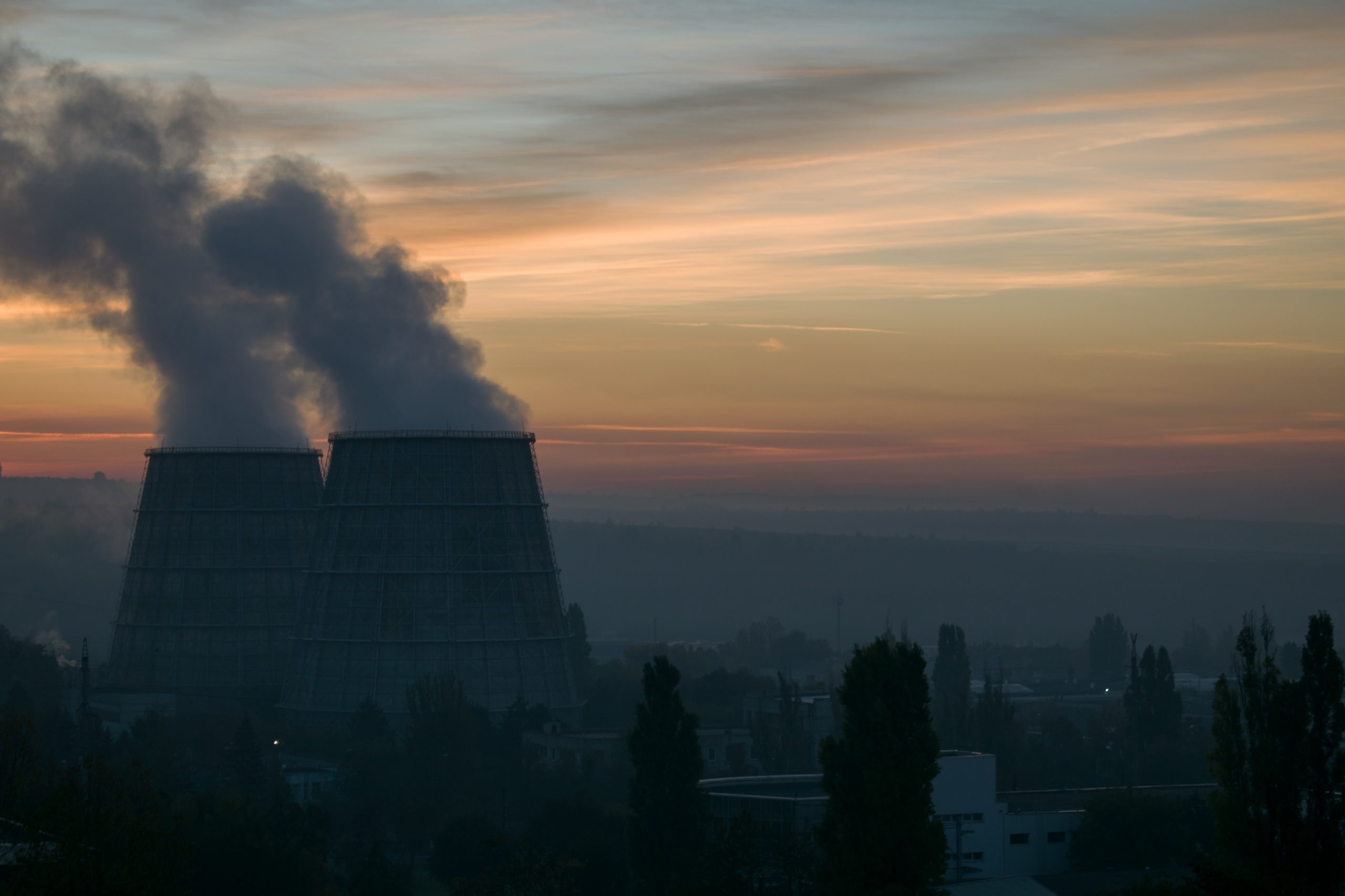 Image of cooling towers against horizon