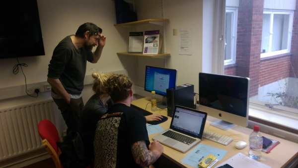 Chris Warne and two of the MA mentors, Jimmy and Kasia in the TEL trainin room, getting their heads around Padlet