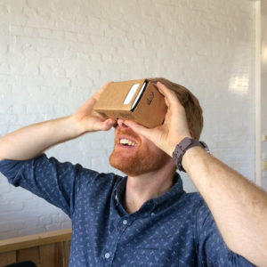 A photo of a user trying Google Cardboard