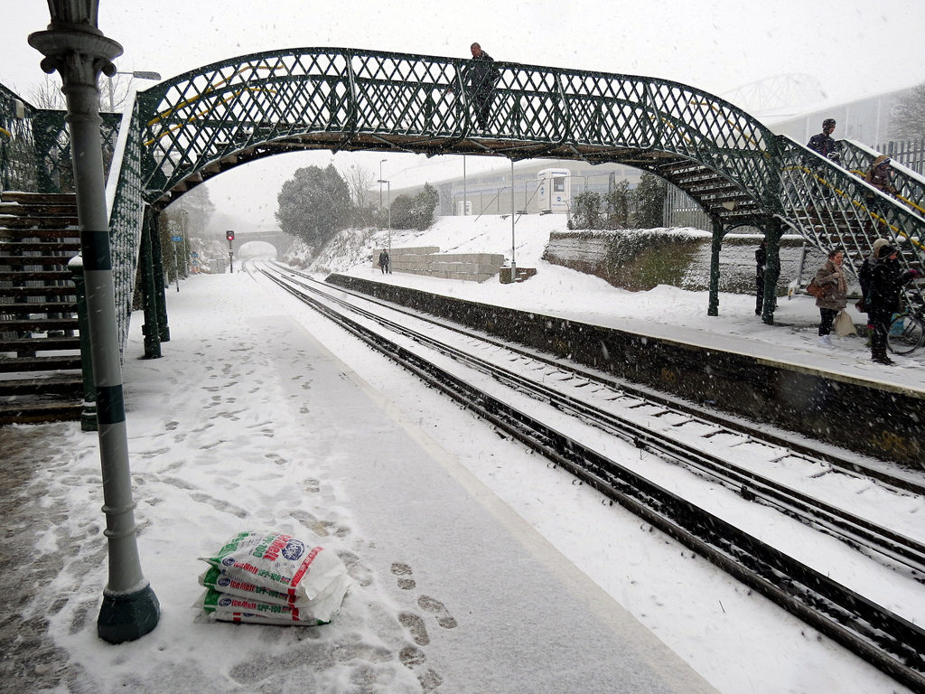 """Light Snow Apocalypse \u2013 Falmer Station"" by justinpickard is licensed under CC BY-SA 2.0  https://www.flickr.com/photos/31290193@N06/8392514122 https://www.flickr.com/photos/31290193@N06 https://creativecommons.org/licenses/by-sa/2.0"