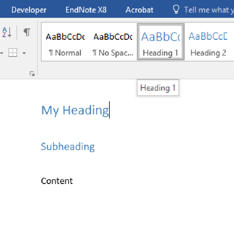 Applying a Heading 1 style to the main document heading.